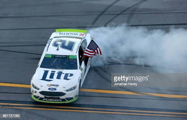 Brad Keselowski driver of the Miller Lite Ford celebrates winning the Monster Energy NASCAR Cup Series Alabama 500 at Talladega Superspeedway on...
