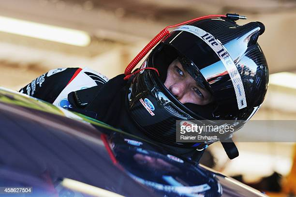 Brad Keselowski driver of the Miller Lite Ford climbs into his car during practice for the NASCAR Sprint Cup Series Quicken Loans 500 at Phoenix...