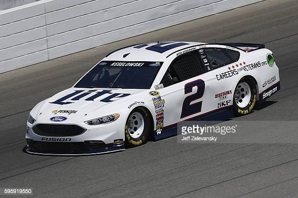 Brad Keselowski driver of the Miller Lite Ford drives during practice for the NASCAR Sprint Cup Series Pure Michigan 400 at Michigan International...