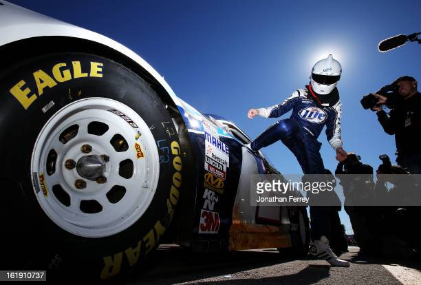 Brad Keselowski driver of the Miller Lite Ford gets out of his car after qualifying for the NASCAR Sprint Cup Series Daytona 500 at Daytona...