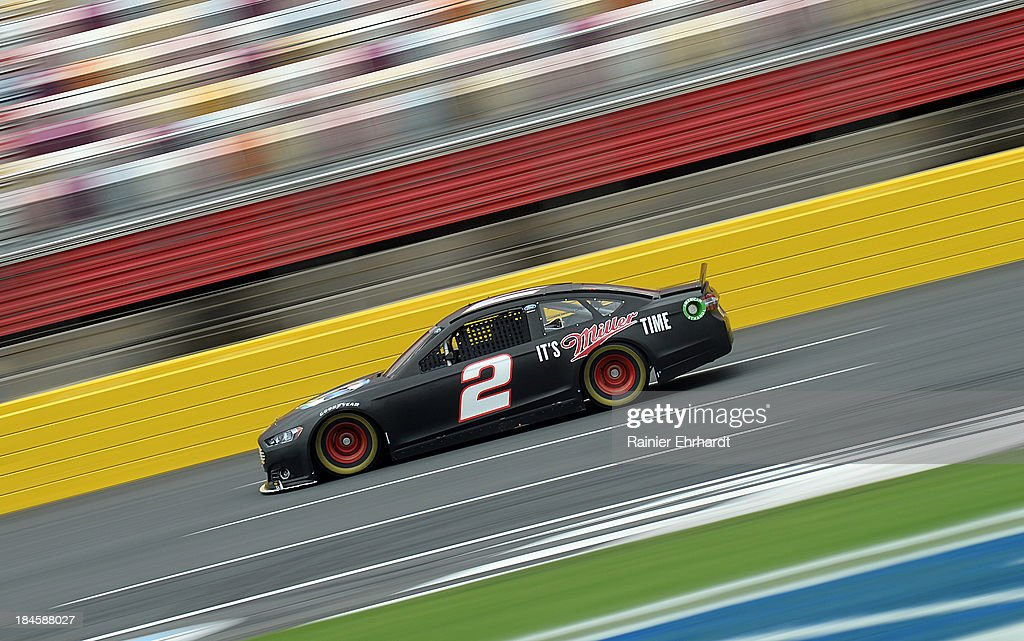 Brad Keselowski, driver of the #2 Miller Lite Ford, goes through the tri-oval during NASCAR Sprint Cup Series testing at Charlotte Motor Speedway on October 14, 2013 in Concord, North Carolina.