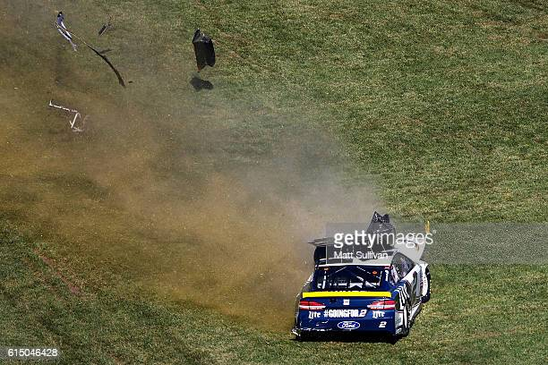 Brad Keselowski driver of the Miller Lite Ford is involved in an ontrack incident during the NASCAR Sprint Cup Series Hollywood Casino 400 at Kansas...