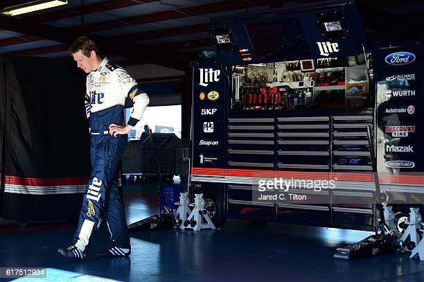 Brad Keselowski driver of the Miller Lite Ford is seen in the garage after an ontrack incident during the NASCAR Sprint Cup Series Hellmann's 500 at...