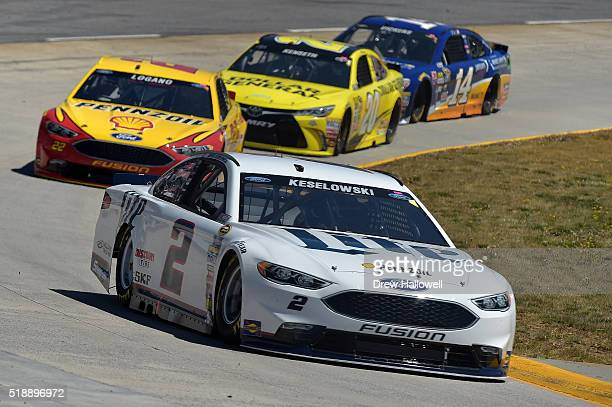 Brad Keselowski driver of the Miller Lite Ford Joey Logano driver of the Shell Pennzoil Ford Matt Kenseth driver of the Dollar General Toyota and...