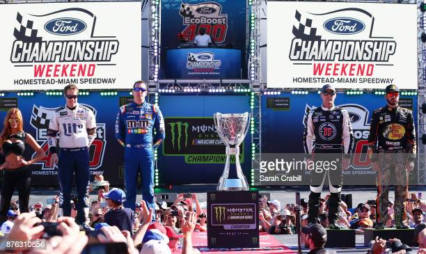 Brad Keselowski driver of the Miller Lite Ford Kyle Busch driver of the MM's Caramel Toyota Kevin Harvick driver of the Jimmy John's Ford and Martin...