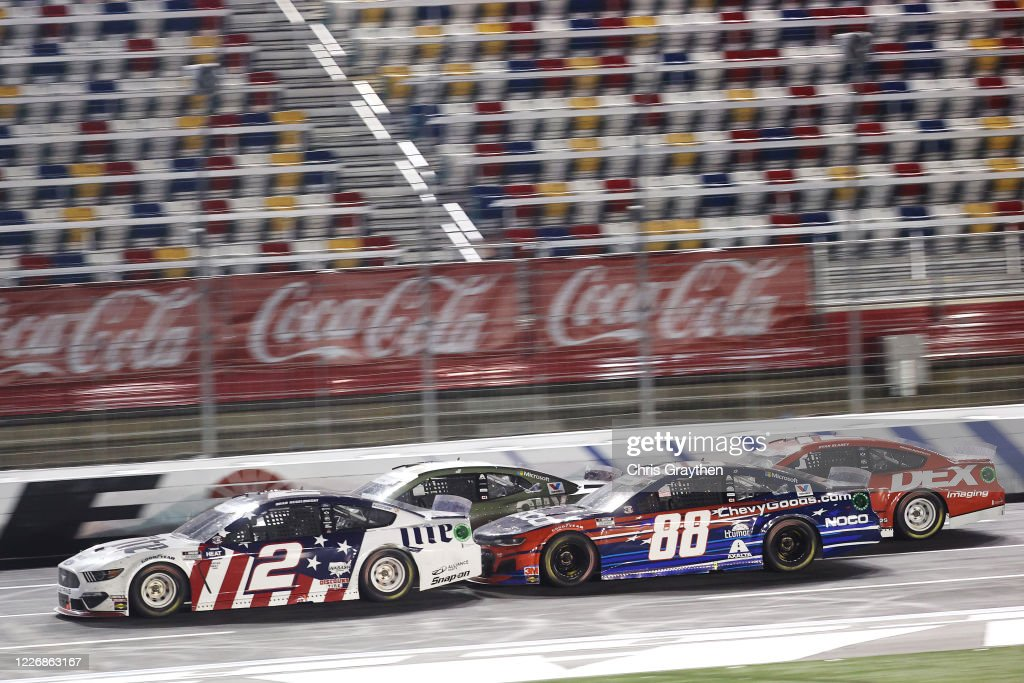 Brad Keselowski, driver of the Miller Lite Ford, leads a pack of ...