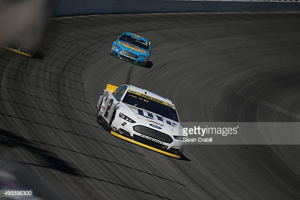 Brad Keselowski driver of the Miller Lite Ford leads a pack of cars during the NASCAR Sprint Cup Series myAFibRiskcom 400 at Chicagoland Speedway on...