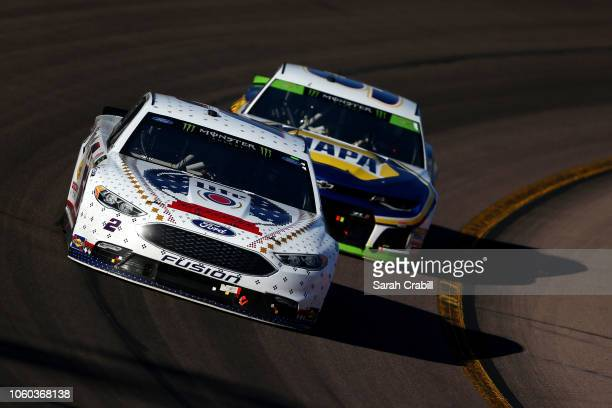 Brad Keselowski driver of the Miller Lite Ford leads Chase Elliott driver of the NAPA Auto Parts Chevrolet during the Monster Energy NASCAR Cup...