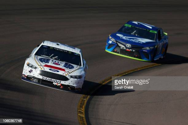 Brad Keselowski driver of the Miller Lite Ford leads Martin Truex Jr driver of the AutoOwners Insurance Toyota during the Monster Energy NASCAR Cup...