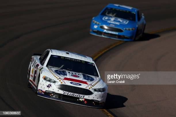Brad Keselowski driver of the Miller Lite Ford leads Ryan Blaney driver of the PPG Ford during the Monster Energy NASCAR Cup Series CanAm 500 at ISM...