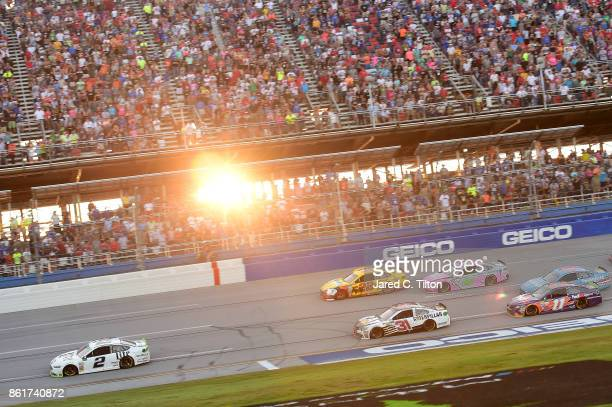 Brad Keselowski driver of the Miller Lite Ford leads the field during the Monster Energy NASCAR Cup Series Alabama 500 at Talladega Superspeedway on...