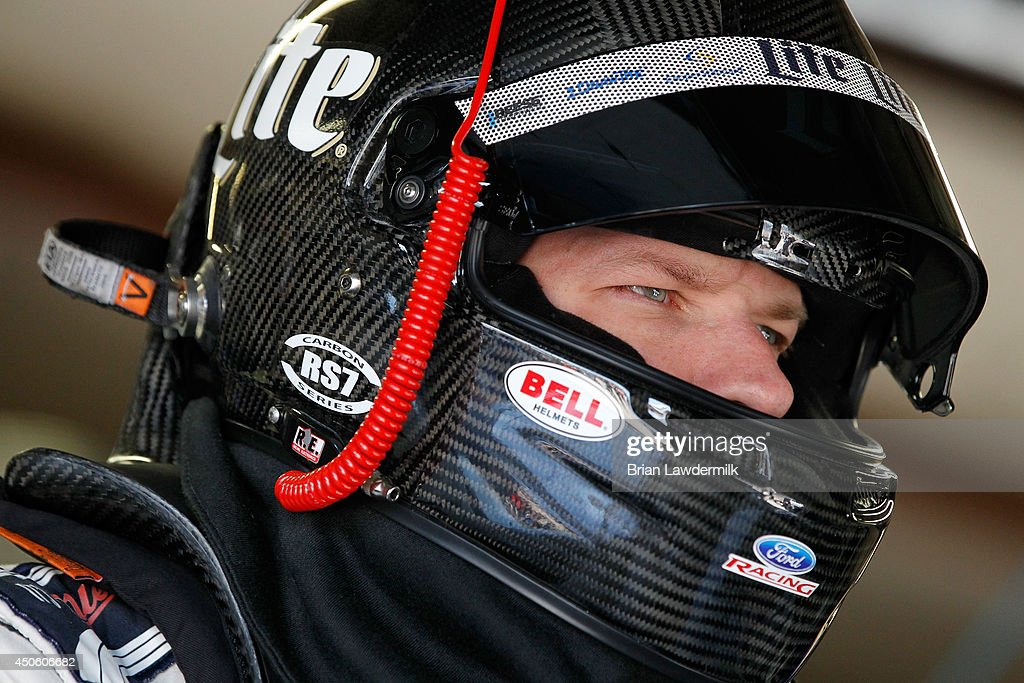 Brad Keselowski, driver of the #2 Miller Lite Ford, looks on in the garage area during practice for the NASCAR Sprint Cup Series Quicken Loans 400 at Michigan International Speedway on June 14, 2014 in Brooklyn, Michigan.