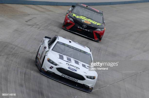 Brad Keselowski driver of the Miller Lite Ford Martin Truex Jr driver of the 5hour ENERGY/Bass Pro Shops Toyota race during the Monster Energy NASCAR...