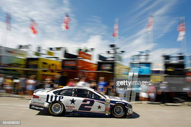 Brad Keselowski driver of the Miller Lite Ford passes through the garage area during practice for the NASCAR Sprint Cup Series CocaCola 600 at...