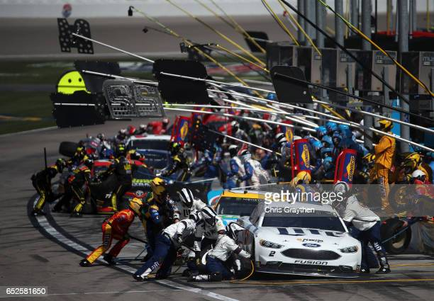 Brad Keselowski driver of the Miller Lite Ford pits along with others during the Monster Energy NASCAR Cup Series Kobalt 400 at Las Vegas Motor...