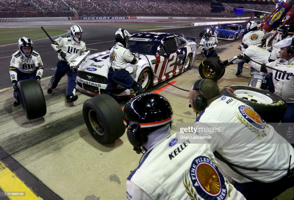 Brad Keselowski, driver of the Miller Lite Ford, pits ...