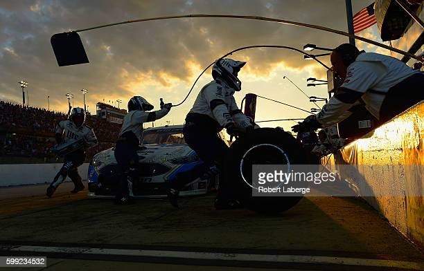 Brad Keselowski driver of the Miller Lite Ford pits during the NASCAR Sprint Cup Series Bojangles' Southern 500 at Darlington Raceway on September 4...