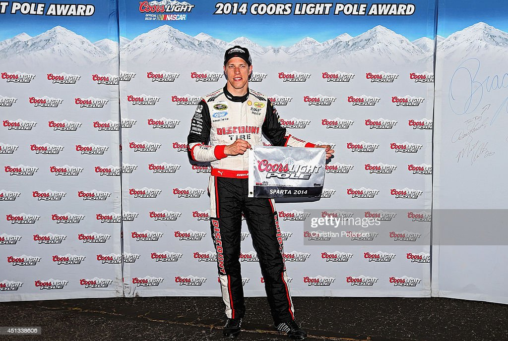 Brad Keselowski, driver of the #2 Miller Lite Ford, poses with the Coors Light Pole Award after qualifying for the pole for the NASCAR Sprint Cup Series Quaker State 400 presented by Advance Auto Parts at Kentucky Speedway on June 27, 2014 in Sparta, Kentucky.
