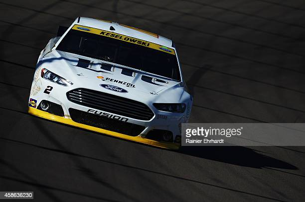 Brad Keselowski driver of the Miller Lite Ford practices for the NASCAR Sprint Cup Series Quicken Loans 500 at Phoenix International Raceway on...