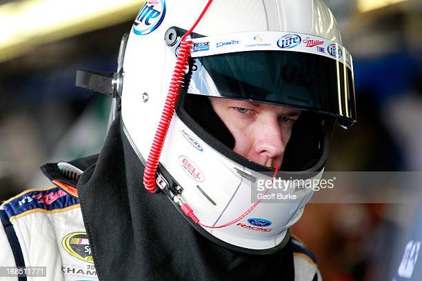 Brad Keselowski driver of the Miller Lite Ford prepares to climb into his car in the garage prior to practice for the NASCAR Sprint Cup Series...