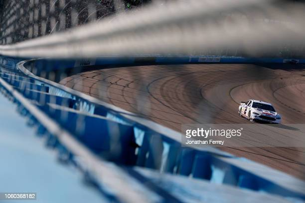 Brad Keselowski driver of the Miller Lite Ford races during the Monster Energy NASCAR Cup Series CanAm 500 at ISM Raceway on November 11 2018 in...