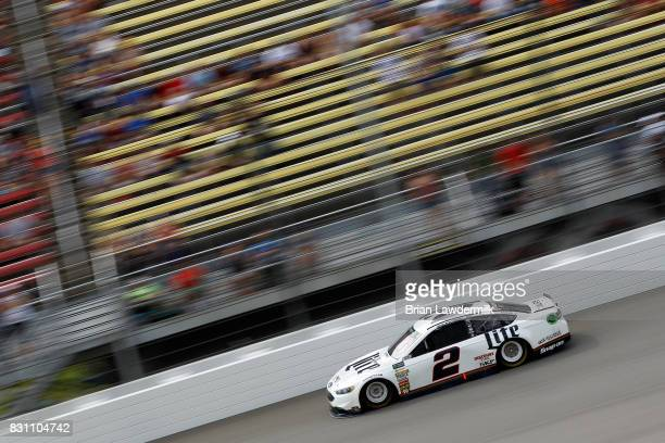 Brad Keselowski driver of the Miller Lite Ford races during the Monster Energy NASCAR Cup Series Pure Michigan 400 at Michigan International Speedway...