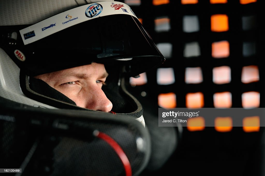 Brad Keselowski, driver of the #2 Miller Lite Ford, sits in his car during practice for the NASCAR Sprint Cup Series AAA 400 at Dover International Speedway on September 28, 2013 in Dover, Delaware.