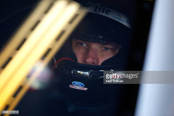 Brad Keselowski, driver of the Miller Lite Ford, sits in his car in the garage area during practice for the NASCAR Sprint Cup Series AAA Texas 500 at...