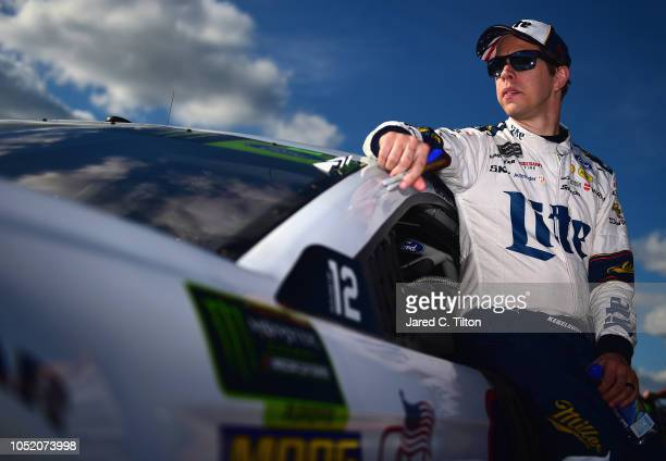 Brad Keselowski driver of the Miller Lite Ford stands by his car during qualifying for the Monster Energy NASCAR Cup Series 1000Bulbscom 500 at...