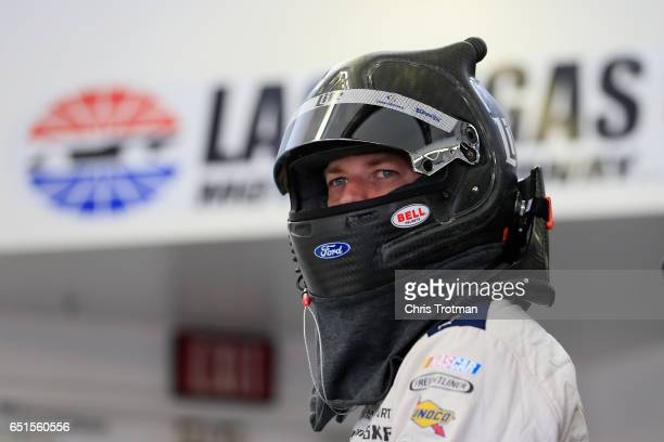 Brad Keselowski driver of the Miller Lite Ford stands in the garage area during practice for the Monster Energy NASCAR Cup Series Kobalt 400 at Las...