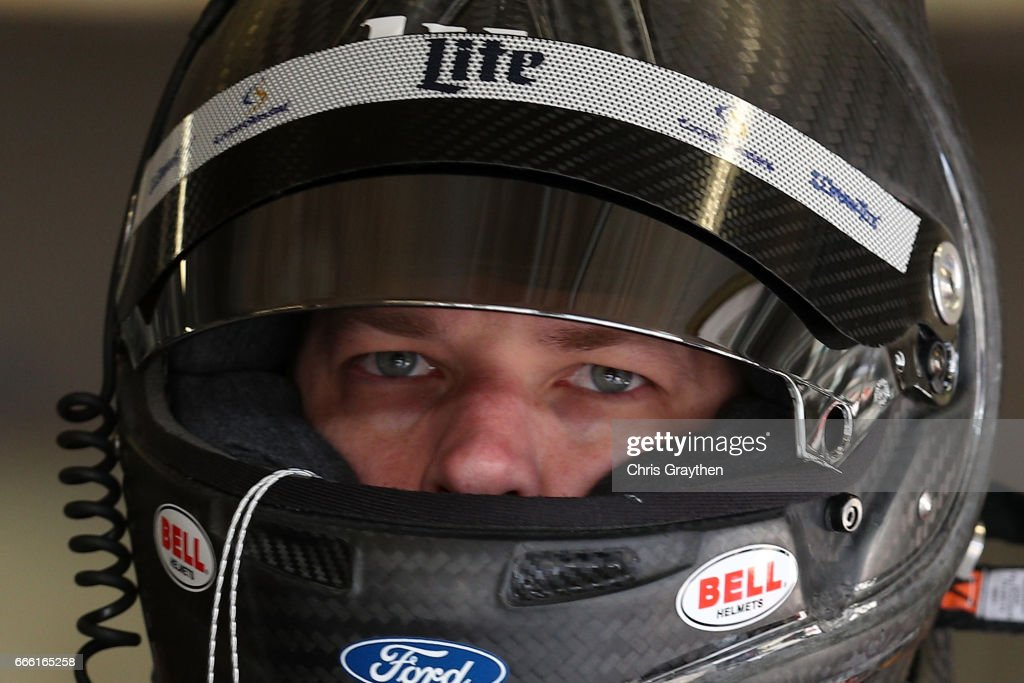 Brad Keselowski, driver of the #2 Miller Lite Ford, stands in the garage area during practice for the Monster Energy NASCAR Cup Series O'Reilly Auto Parts 500 at Texas Motor Speedway on April 8, 2017 in Fort Worth, Texas.