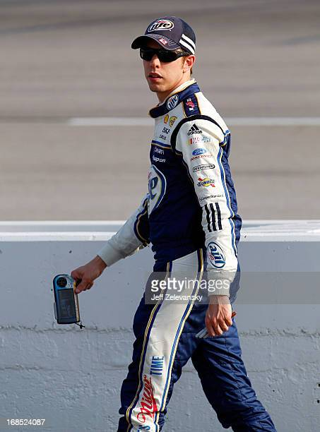 Brad Keselowski driver of the Miller Lite Ford stands on the grid during qualifying for the NASCAR Sprint Cup Series Bojangles' Southern 500 at...