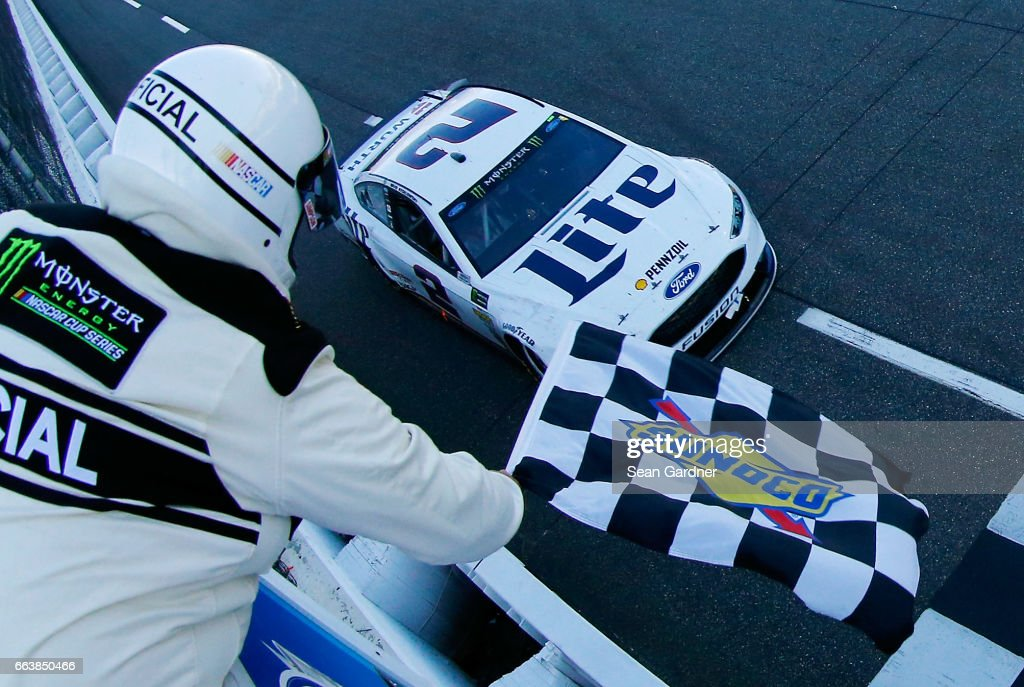 Brad Keselowski, driver of the #2 Miller Lite Ford, takes the checkered flag during the Monster Energy NASCAR Cup Series STP 500 at Martinsville Speedway on April 2, 2017 in Martinsville, Virginia.