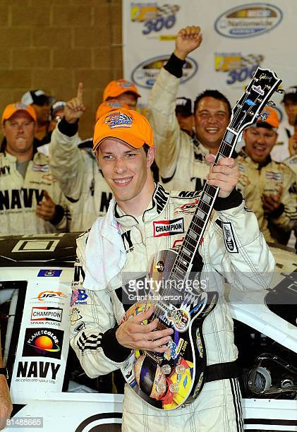 Brad Keselowski driver of the NAVY Chevrolet celebrates in victory lane after winning the NASCAR Nationwide Series Federated Auto Parts 300 presented...