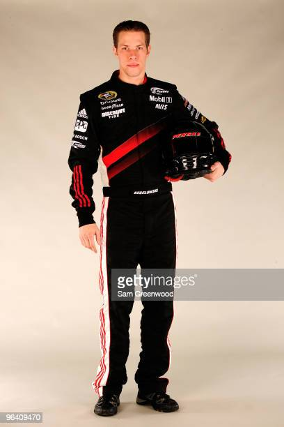 Brad Keselowski driver of the Penske Racing Dodge poses during NASCAR media day at Daytona International Speedway on February 4 2010 in Daytona Beach...