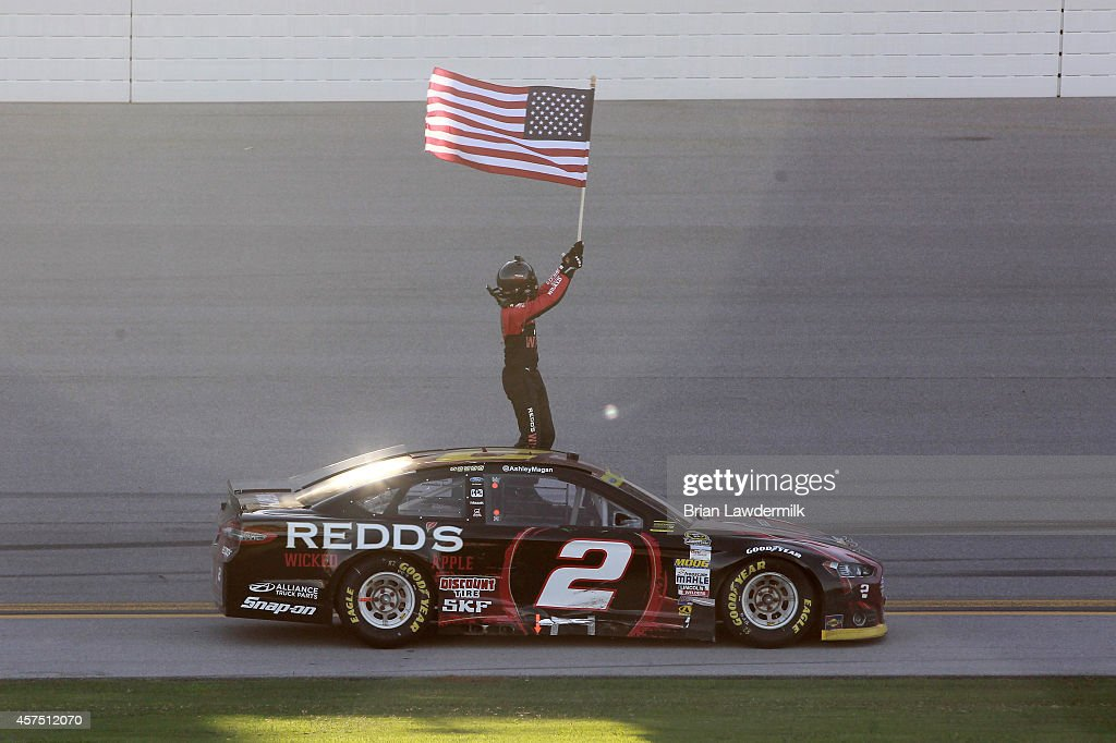 Brad Keselowski, driver of the #2 Redd's Wicked Apple Ale Ford, celebrates after winning the NASCAR Sprint Cup Series GEICO 500 at Talladega Superspeedway on October 19, 2014 in Talladega, Alabama.