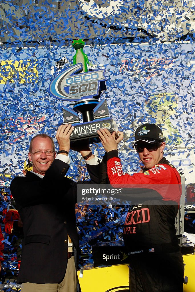 Brad Keselowski, driver of the #2 Redd's Wicked Apple Ale Ford, celebrates in Victory Lane after winning the NASCAR Sprint Cup Series GEICO 500 at Talladega Superspeedway on October 19, 2014 in Talladega, Alabama.