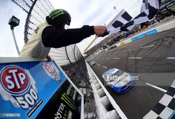 Brad Keselowski driver of the Reese/Draw Tite Ford crosses the finish line to win the Monster Energy NASCAR Cup Series STP 500 at Martinsville...