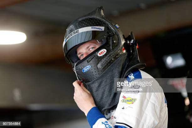 Brad Keselowski driver of the Reese/DrawTite Ford stands in the garage area during practice for the Monster Energy NASCAR Cup Series STP 500 at...