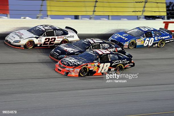 Brad Keselowski, driver of the Ruby Tuesday Dodge, leads Justin Allgaier, driver of the Verizion Wireless Dodge, Kyle Busch, driver of the Z-Line...