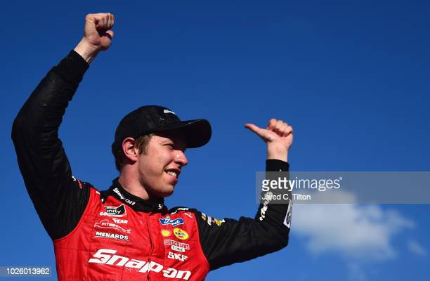 Brad Keselowski driver of the Snap On Ford celebrates in Victory Lane after winning the NASCAR Xfinity Series Sport Clips Haircuts VFW 200 at...