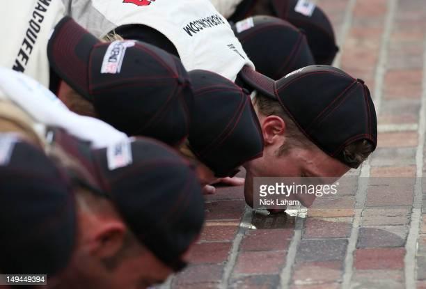 Brad Keselowski, driver of the Snap-On Tools Dodge, kisses the bricks after winning the NASCAR Nationwide Series Indiana 250 at Indianapolis Motor...