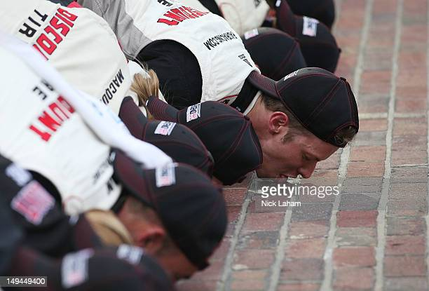 Brad Keselowski driver of the SnapOn Tools Dodge kisses the bricks after winning the NASCAR Nationwide Series Indiana 250 at Indianapolis Motor...