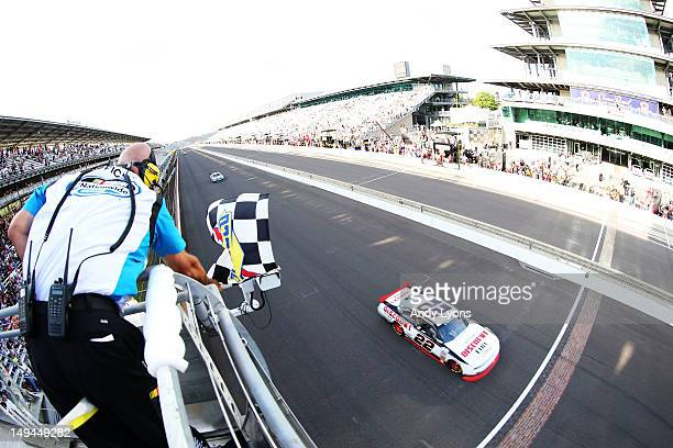 Brad Keselowski, driver of the Snap-On Tools Dodge, races to the finishline to win the NASCAR Nationwide Series Indiana 250 at Indianapolis Motor...