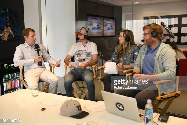 Brad Keselowski driver of the Team Penske Ford Fusion Ryan Blaney driver of the Team Penske Ford Fusion Kim Coon and Chuck Busch during a live...
