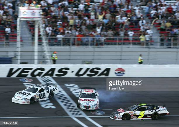 Brad Keselowski driver of the US NAVY Chevrolet and Carl Edwards driver of the Save a lot Ford spin out of control after a incident caused by Mark...