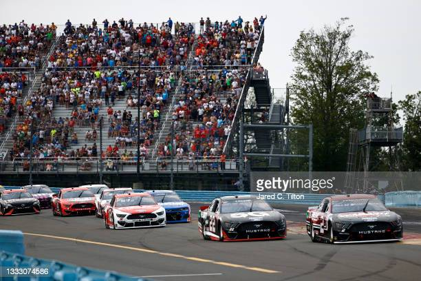 Brad Keselowski, driver of the Wabash National Ford, Joey Logano, driver of the Verizon 5G Ford, and Ryan Blaney, driver of the DEX Imaging Ford,...