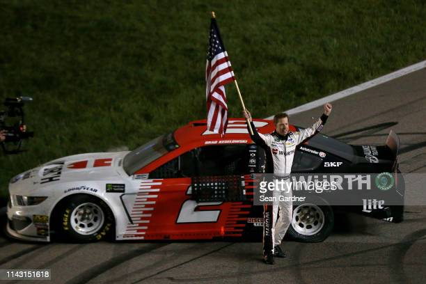Brad Keselowski, driver of the Wurth Ford, celebrates after winning the Monster Energy NASCAR Cup Series Digital Ally 400 at Kansas Speedway on May...