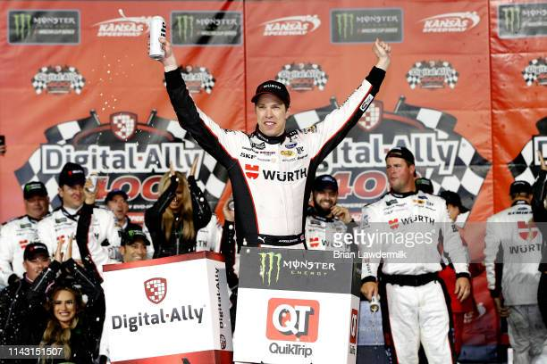 Brad Keselowski driver of the Wurth Ford celebrates in victory lane after winnnig the Monster Energy NASCAR Cup Series Digital Ally 400 at Kansas...