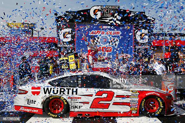 Brad Keselowski, driver of the Wurth Ford, celebrates in Victory Lane after winning the NASCAR Sprint Cup Series Auto Club 400 at Auto Club Speedway...